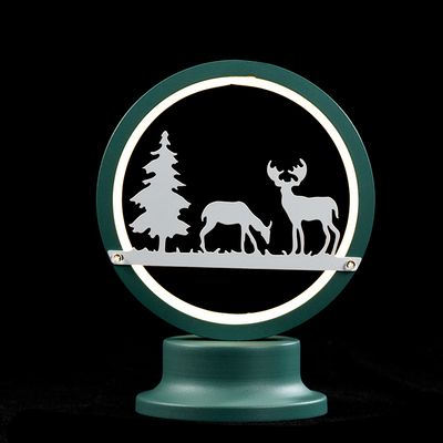 Table light with deer and tree pattern